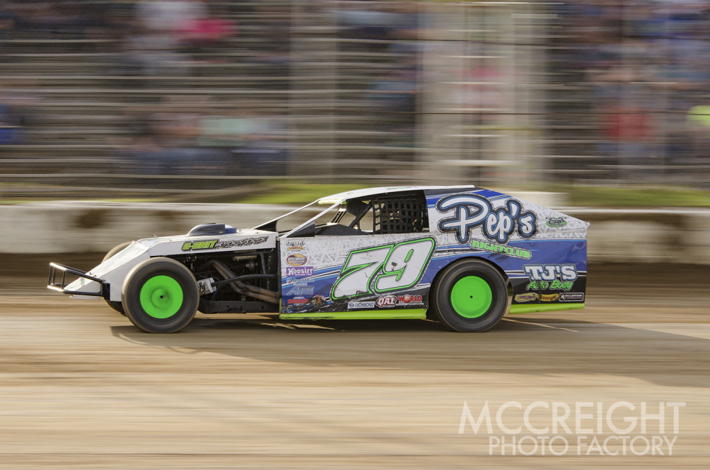 Shawn Fernkes races along side the grandstands